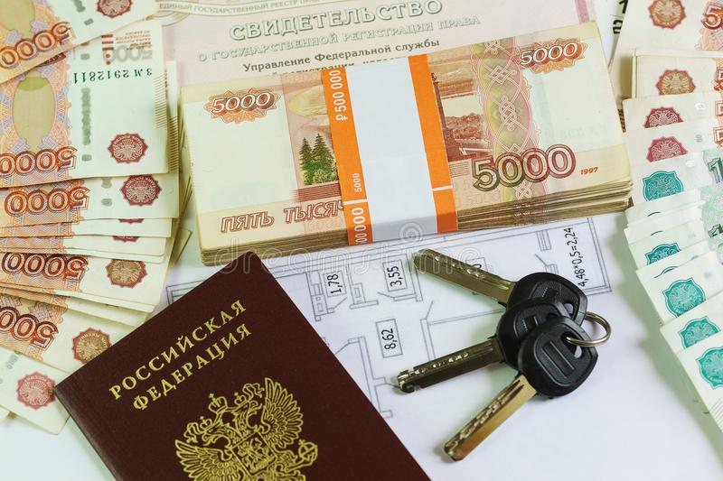Inscription in Russian: Certificate of state registration of real estate. Passport, the plan and the keys to the large amount of R. Ussian money. Purchase of royalty free stock image