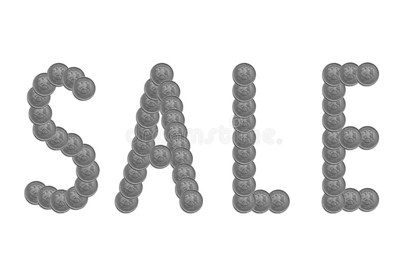 The inscription in Russian - `Sale` is laid out of five Russian ruble coins. royalty free illustration