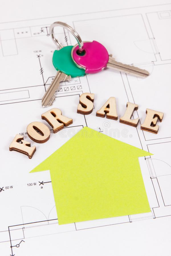 Inscription for sale and home keys on electrical construction housing plan, concept of selling house. Inscription for sale and home keys on electrical stock photo
