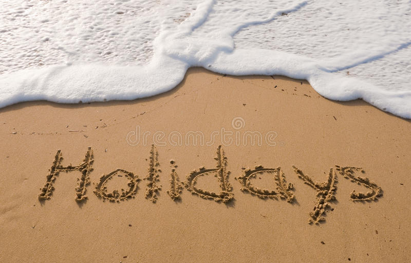 The inscription on the sand - holidays royalty free stock photos