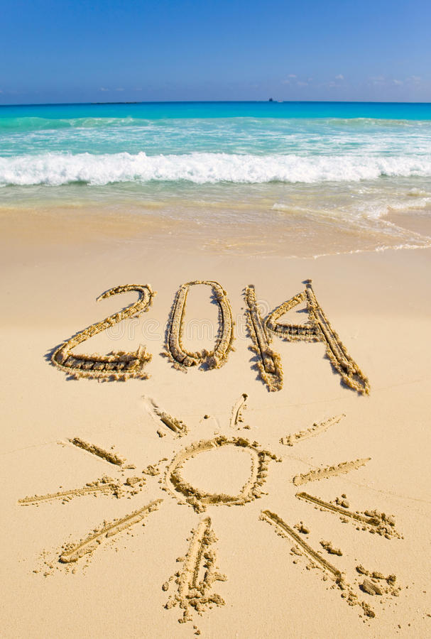 2014 inscription on the sand near the sea.water landscape in a sunny day royalty free stock photography
