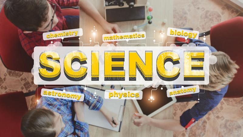 Inscription Science on background of studying kids at school royalty free stock photography