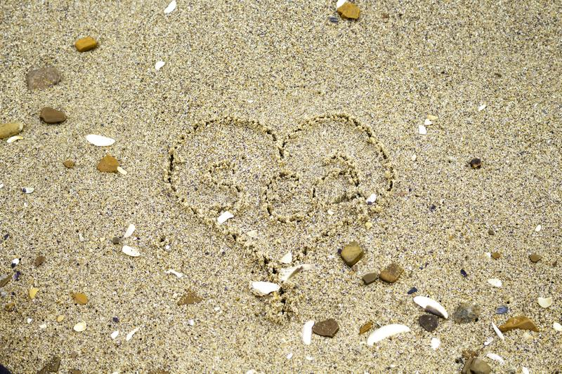 Inscription `sea` on the sea in a painted heart. Close-up royalty free stock photo