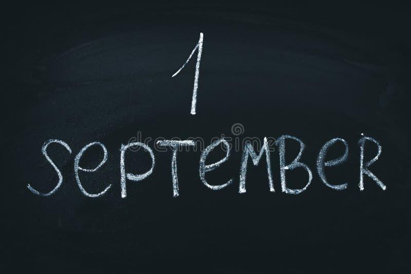 The inscription is September 1. Chalk on a blackboard. stock image