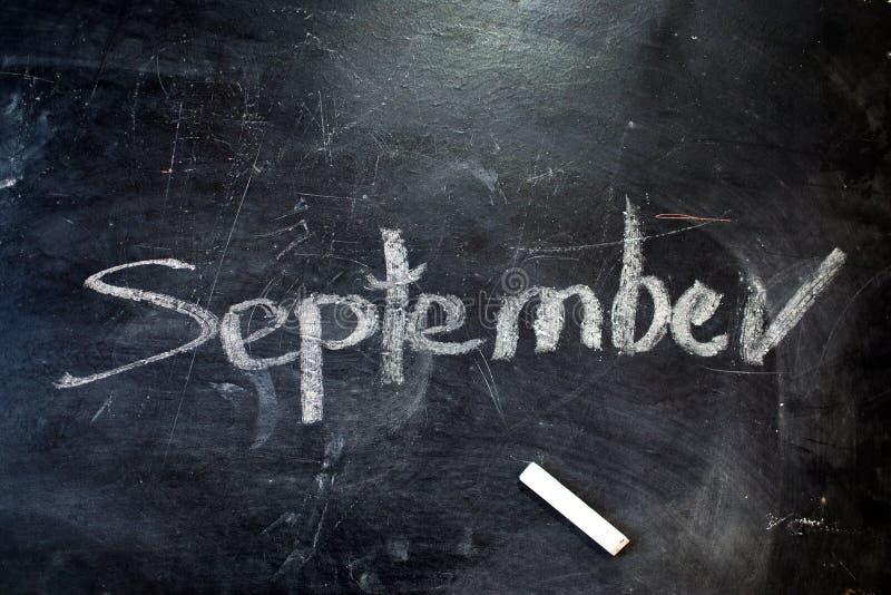 The inscription is September 1. Chalk on a blackboard stock photo