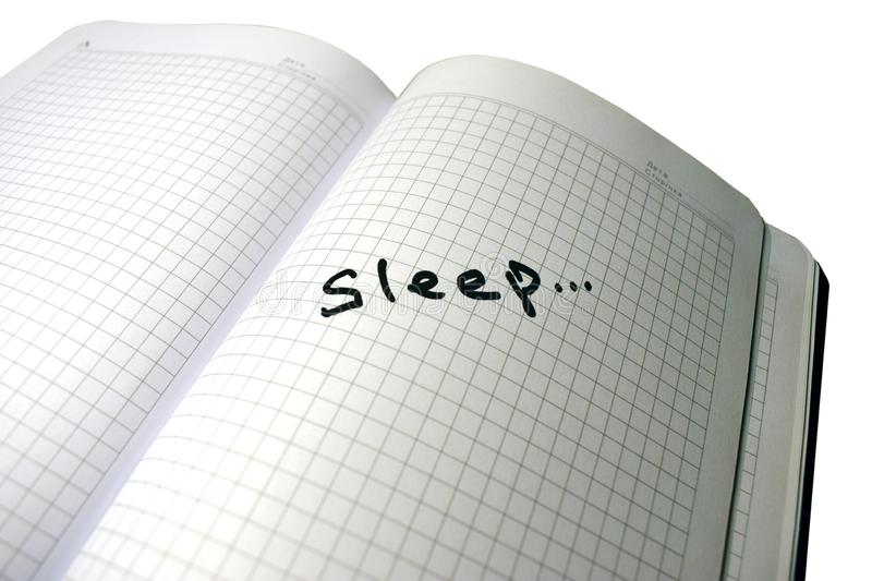 The inscription sleep in a notebook royalty free stock photo