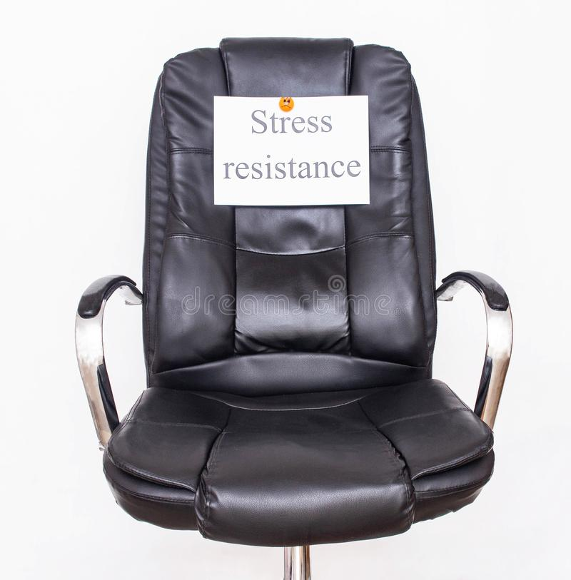 The inscription stress resistance on an office chair. Workplace stress tolerance concept royalty free stock photos
