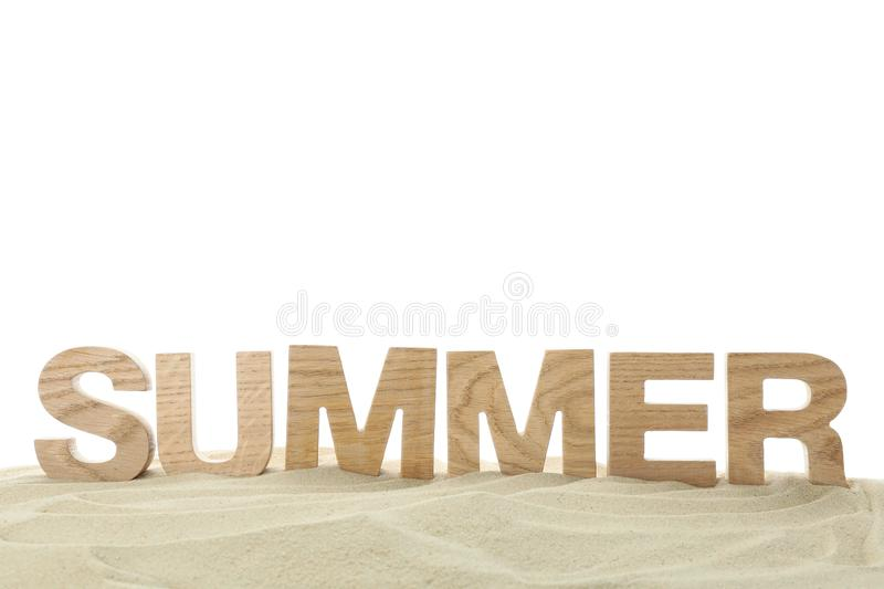 Inscription summer is lined with wooden letters on clear sea sand. Happy holidays stock image