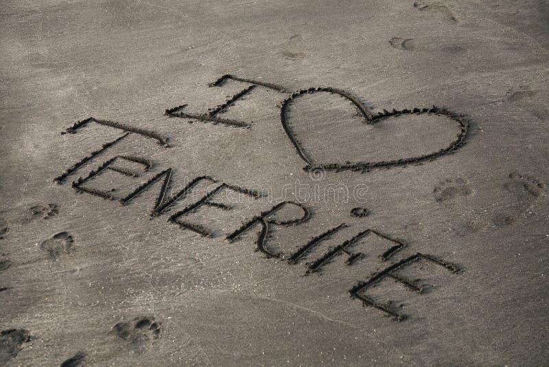 Inscription sur le sable gris images stock