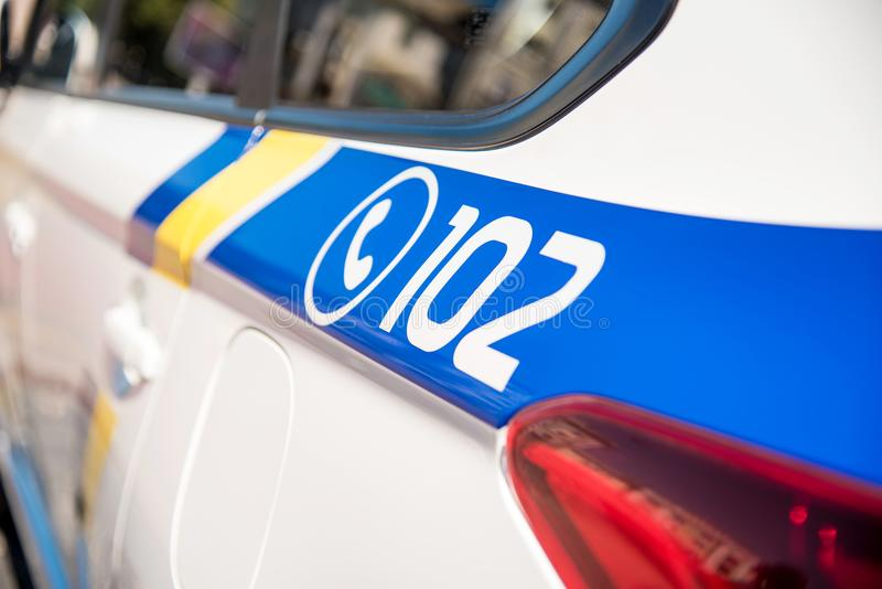 Inscription 102 - telephone number of the police on a patrol car. Security, help, law - concept stock images