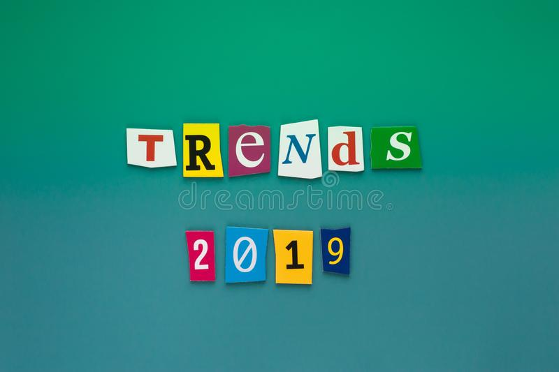 Inscription trends 2019. Abstract card with colored inscription text trends 2019 on green background for concept design. The word. Trends on colored letters royalty free stock images