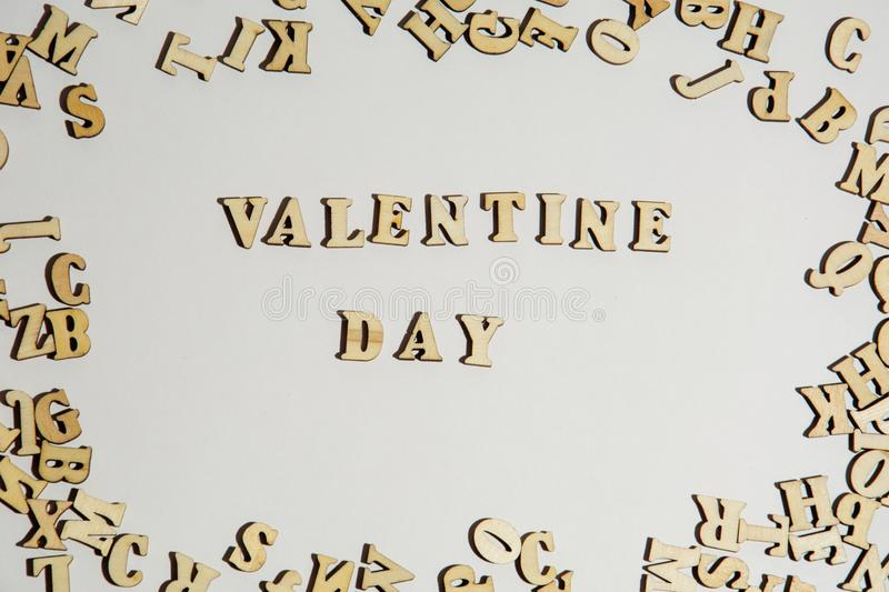 Inscription Valentine Day on white background with the letters. Romantic Valentines day background concept royalty free stock photography