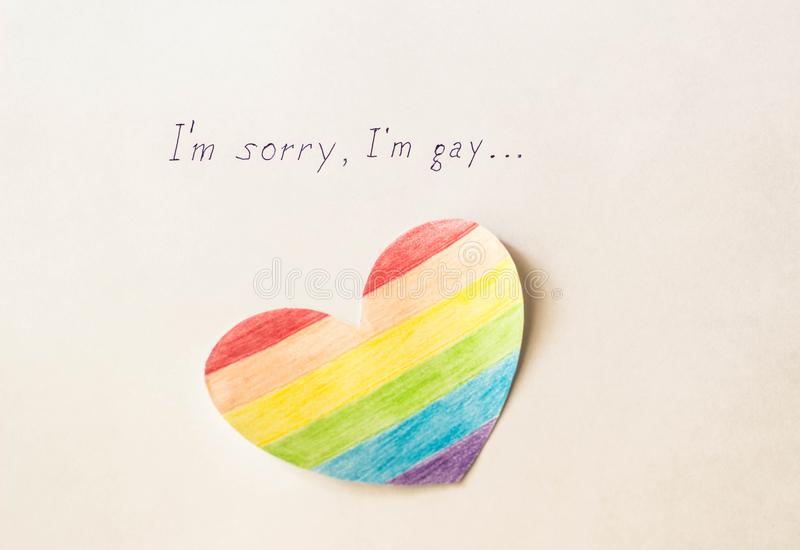 Inscription on white background I`m sorry gay and heart in the form of a flag of lgbt, homosexuality. LGBT royalty free stock photos