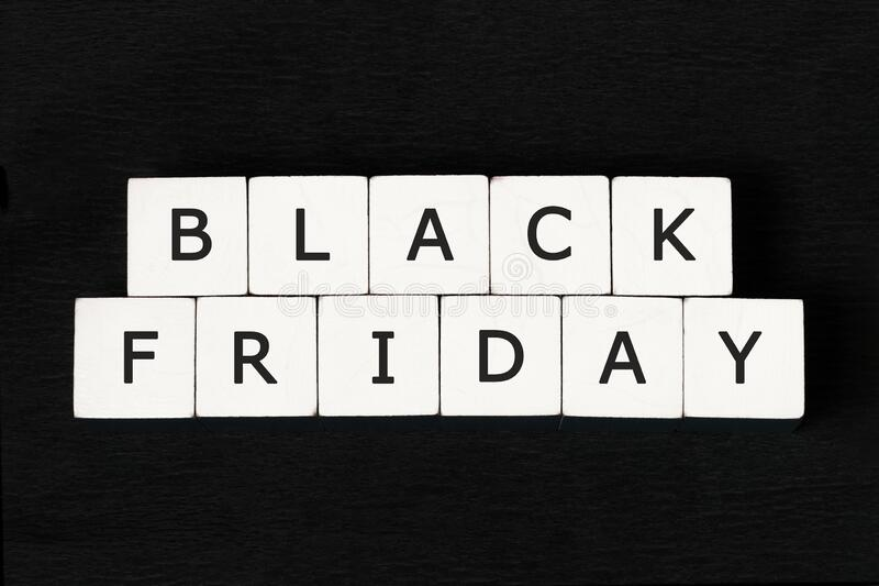Inscription on white cubes: `black friday.` black background. Graphic resources.n royalty free stock photos