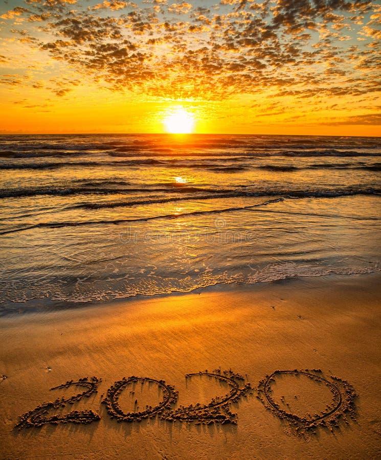 2020 inscription written on sandy beach royalty free stock photos