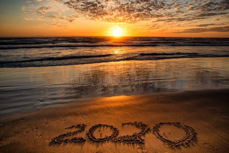 2020 inscription written on sandy beach royalty free stock photography