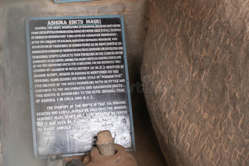 Inscriptions of Emperor Ashoka translated and printed in English inside the cave at Maski, Raichur, India.  stock photography