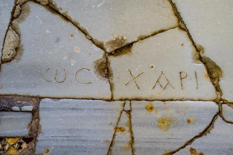 The inscriptions on the marble floor. The floor of the room in the church of St. Nicholas in Demre royalty free stock images