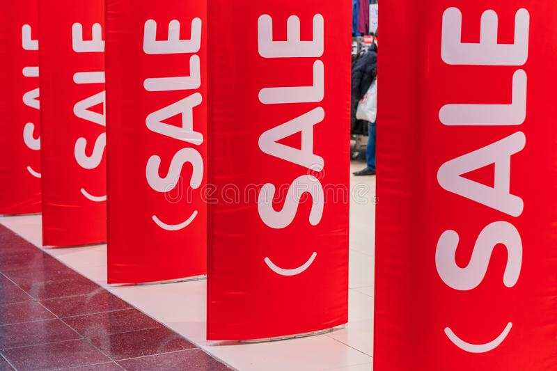 Inscriptions sale on the red pillars.  royalty free stock image