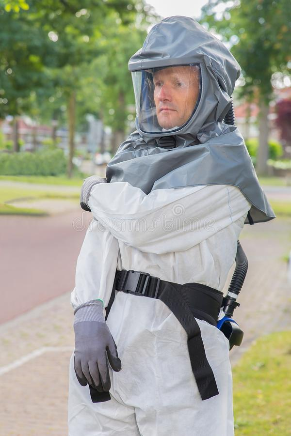 Insect fighter wears airtight work suit stock image