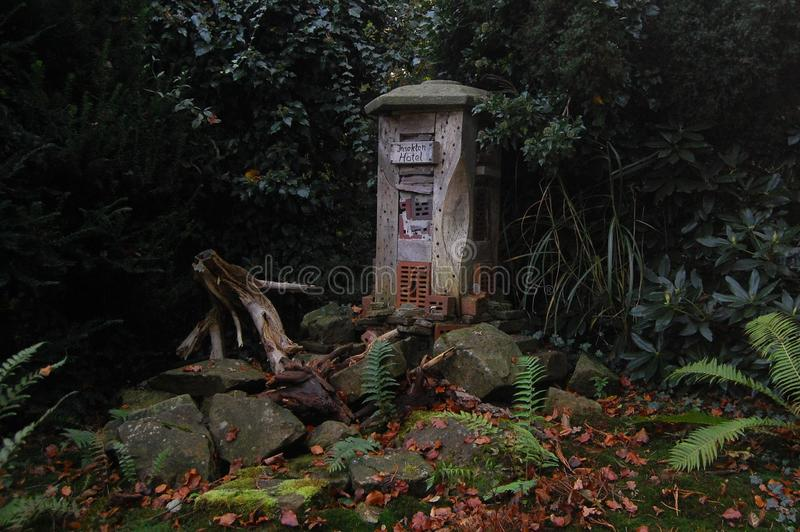 Insect hotel in German garden. royalty free stock image