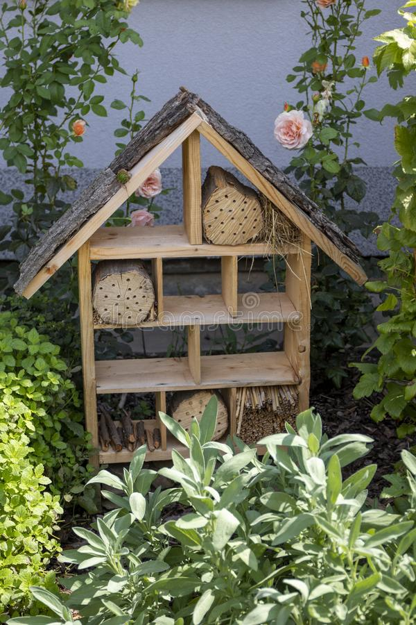 Insect house - hotel for the protection of biodiversity in a summer garden royalty free stock photos