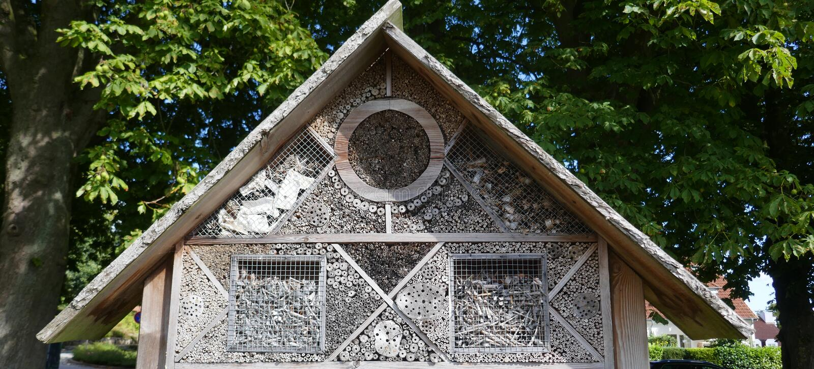 Insect protection, animal welfare. Large Insect hotel on a field in Schleswig-Holstein, Germany stock photo