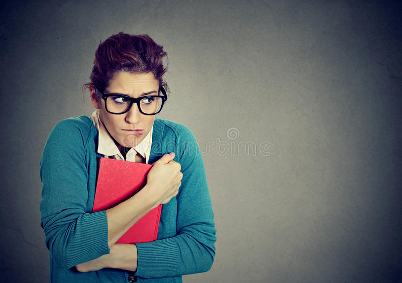 Insecure nerdy young woman student stock photography