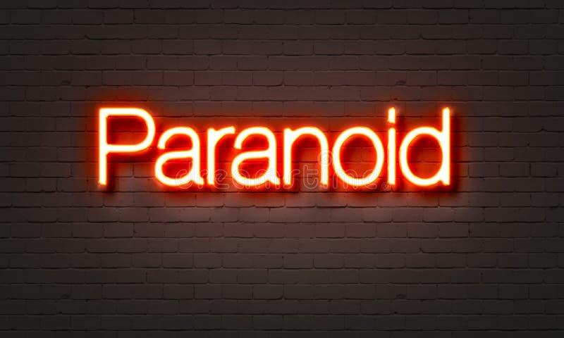 Insegna al neon paranoica sul fondo del muro di mattoni illustrazione di stock