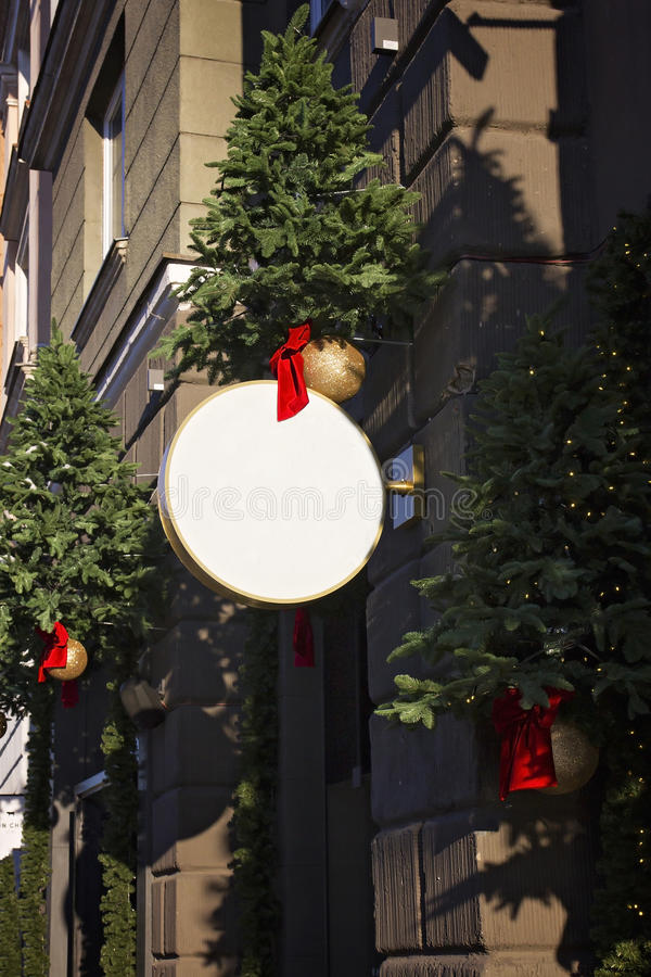 Insegna con le decorazioni di Natale Derisione su Figura rotonda fotografia stock