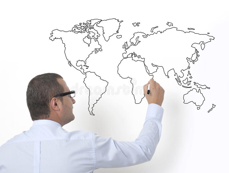 Insegnante che disegna il mappa del mondo fotografie stock