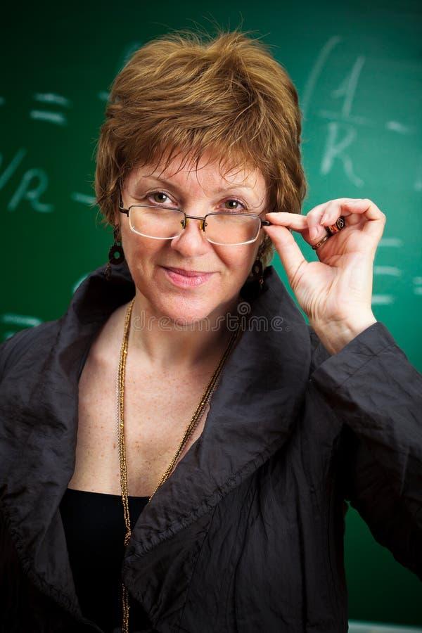 Insegnante con i vetri immagini stock
