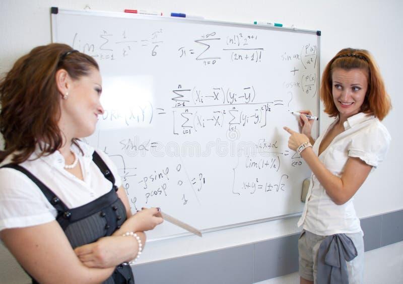 Insegnante ed allievo immagine stock