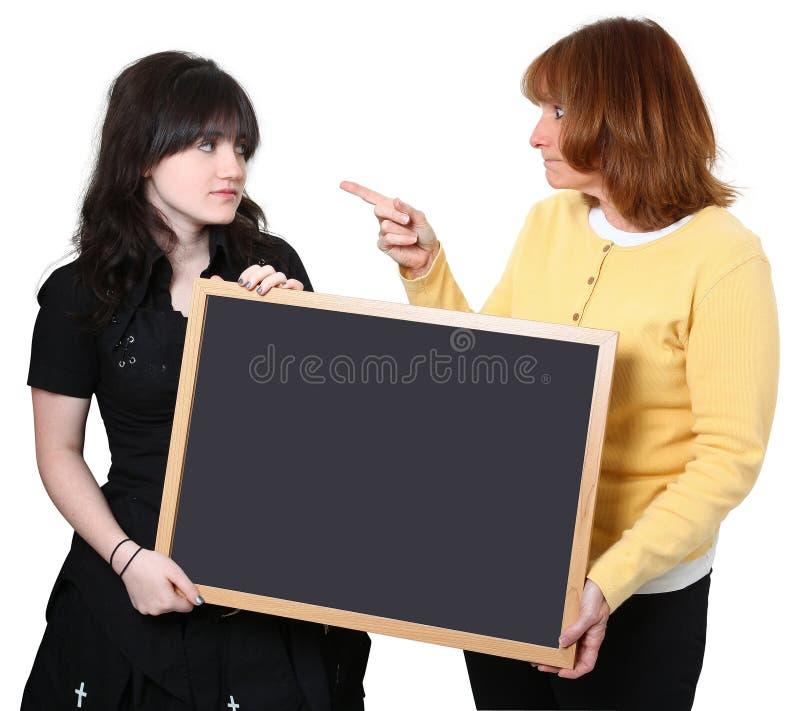 Insegnante ed allievo arrabbiati fotografia stock