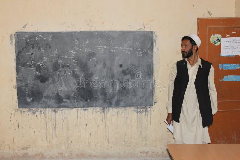 Insegnante per la matematica afgano fotografia stock
