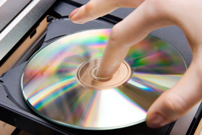 Insert CD into player stock photos