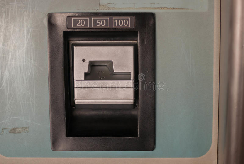 Insert Coin Slot 20 50 100 in quarters royalty free stock photography