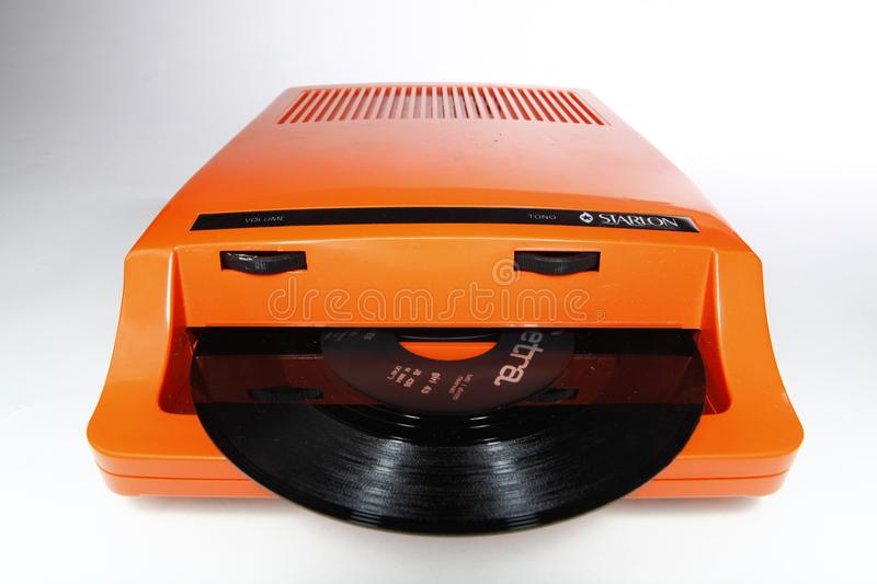 Insert player for 45 rpm vinyl records. Insert player in orange tint, made in plastic for 45 rpm vinyl records royalty free stock images