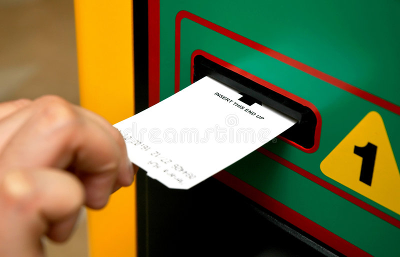Insert ticket to a machine stock photos