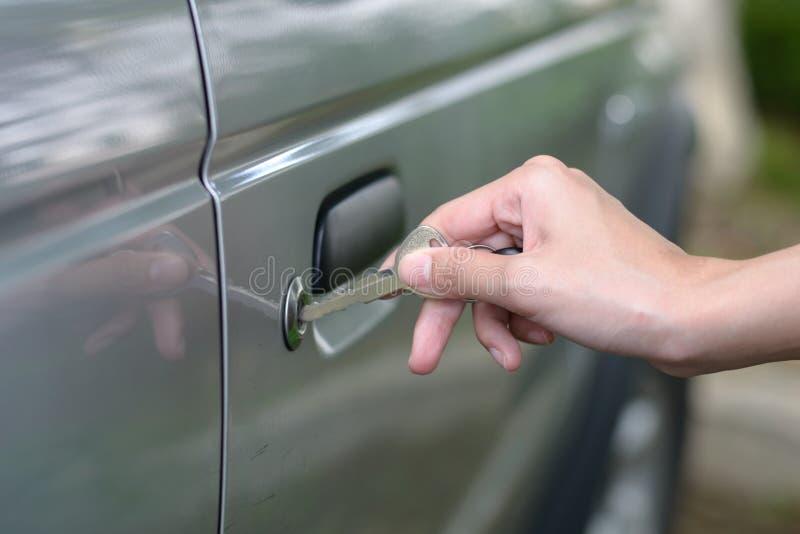 Inserting Car Key. Woman hand inserting car key royalty free stock image