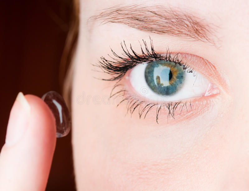 Download Inserting A Contact Lens In Female Eye Stock Photo - Image: 18130972
