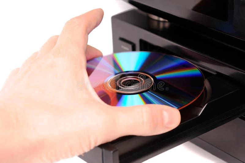 Insertion d'un disque photographie stock libre de droits