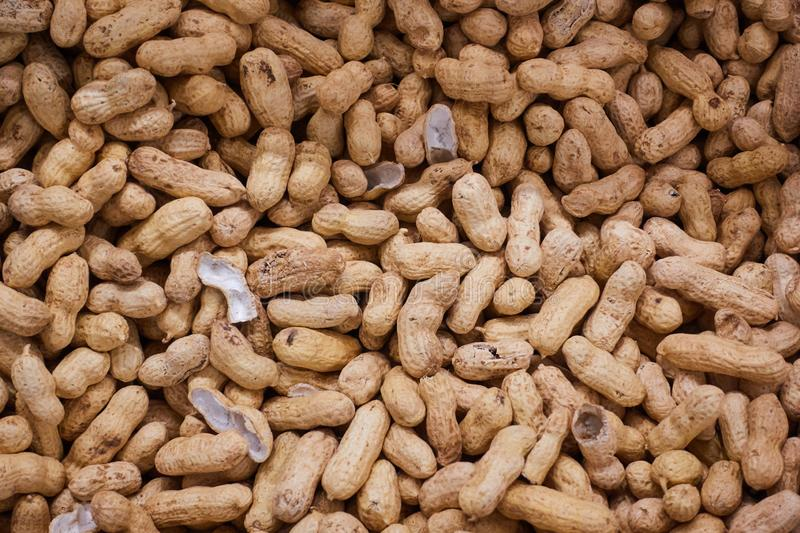Inshell peanuts on the counter of the store.  royalty free stock image