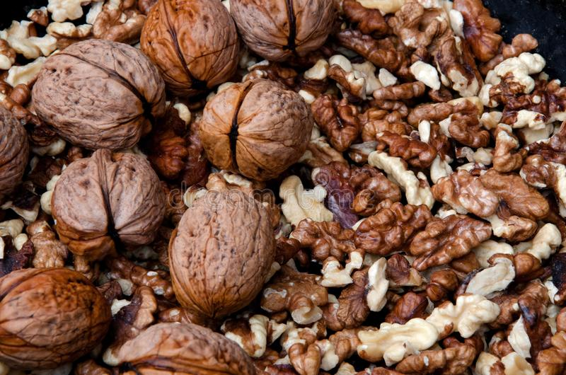 Inshell walnuts and peeled. Harvest of inshell walnuts and peeled stock images