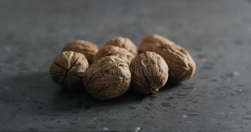 Inshell walnuts on terrazzo countertop stock images