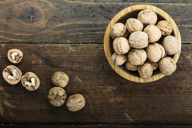 Inshell walnuts on wooden background. Vintage walnuts in shell on a wooden background. simple rustic background. place for text stock photos