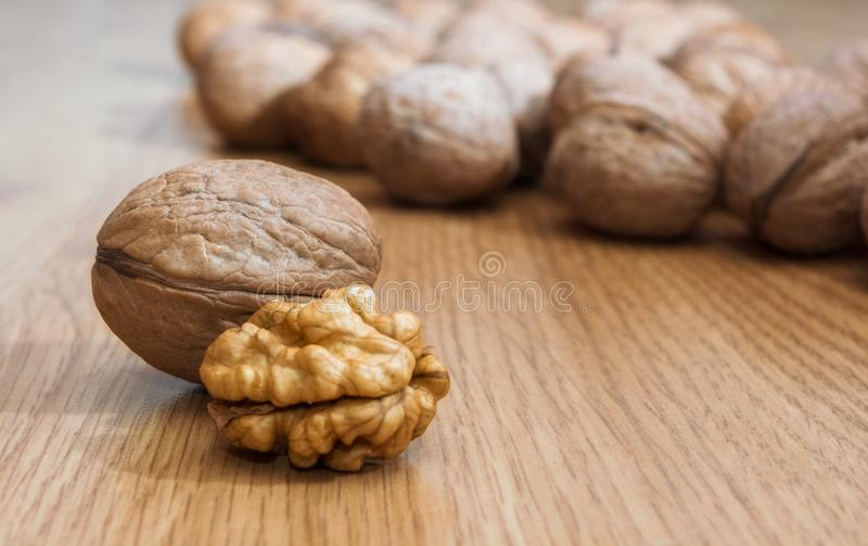 Inshell walnuts on a wooden table. Healthy food. Healthy lifestyle.  stock images