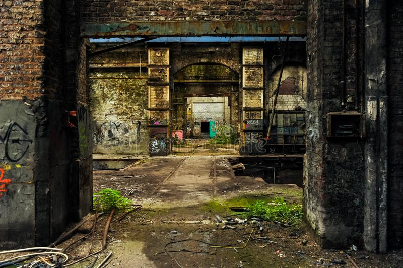 Inside abandoned and weathered factory building. With bird droppings and damaged everything royalty free stock photography