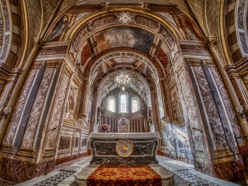Inside of an amazing little Christian church lost in a small village in France stock photo