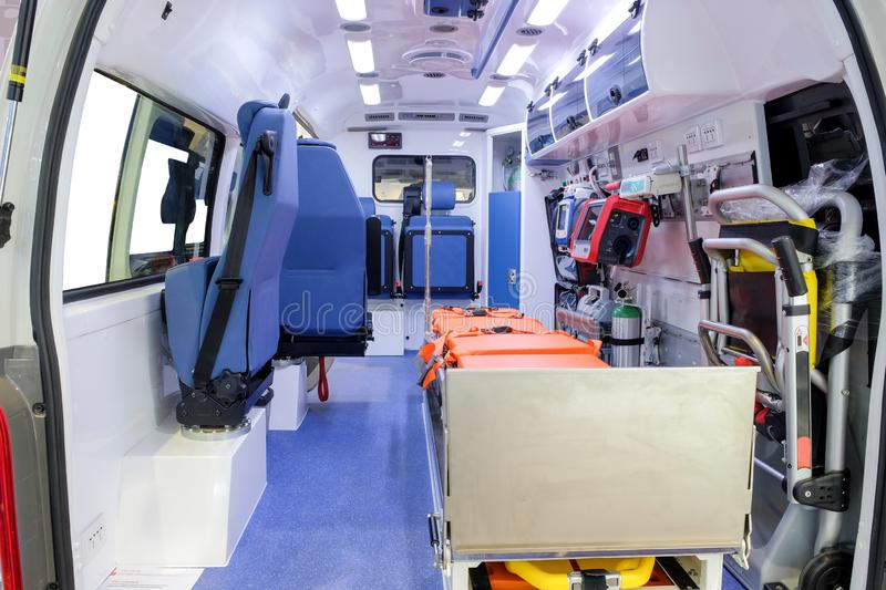 Inside an ambulance car with medical equipment for helping. Patients before delivery to the hospital.n royalty free stock images